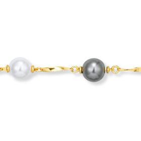 Bracelet plaqué or et perles.