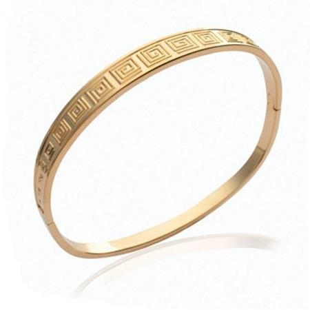 Bracelet plaqué or rigide ouvrant.