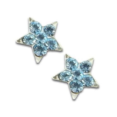 Clous d'oreilles étoiles en argent et cristal bleu.