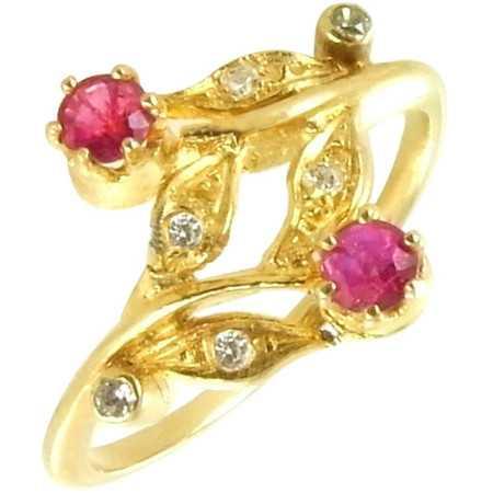 Bague motifs feuilles en or avec rubis et diamants