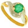 bague or bicolore avec émeraude de 5 x 4 mm et diamant.